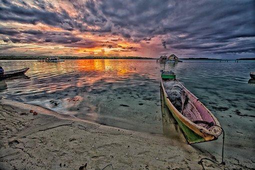 At Dusk, Lagoon, Dugout Canoe