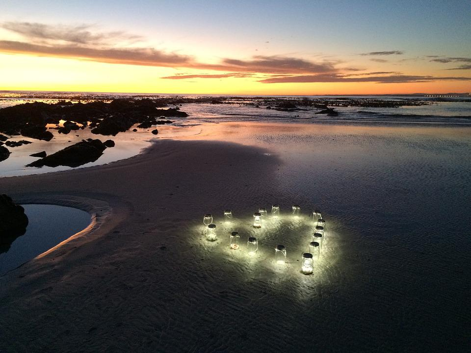 sunset lanterns beach free photo on pixabay