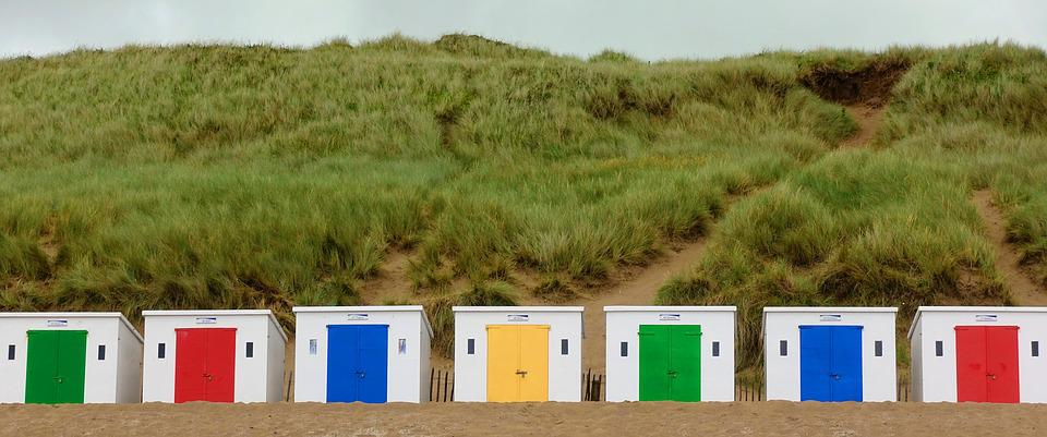 A row of multicolored shelters.