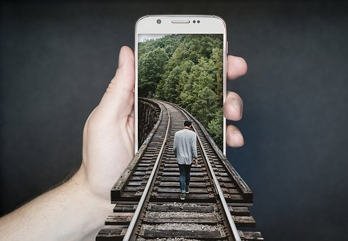 An iphone with train tracks entering it