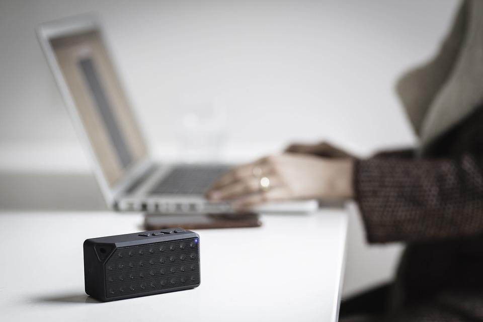 People, Blur, Bluetooth, Speaker, Laptop, Table, Phone