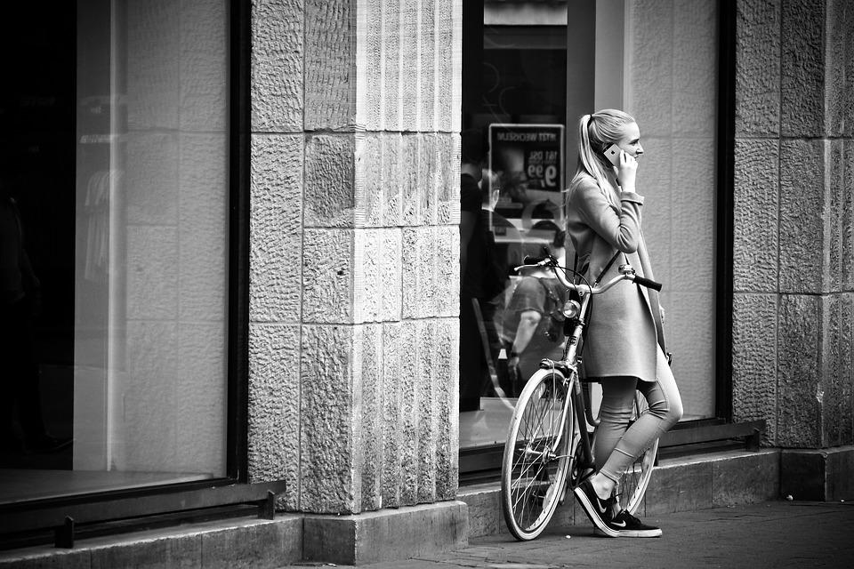 Street photography woman urban road black and white