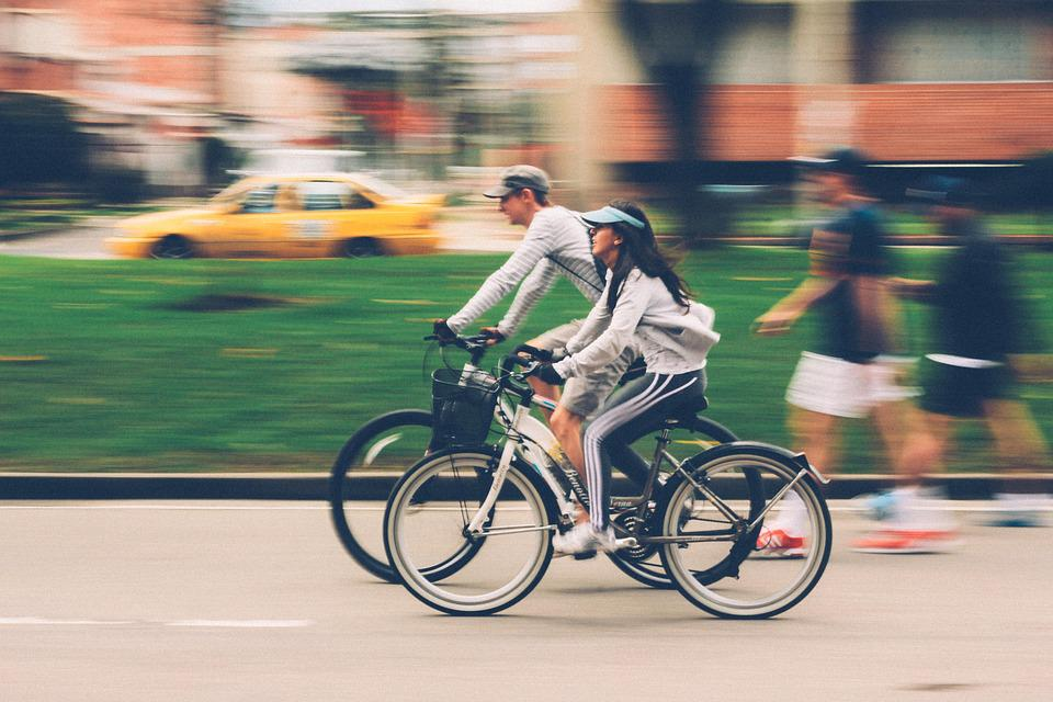 Man and woman cycling
