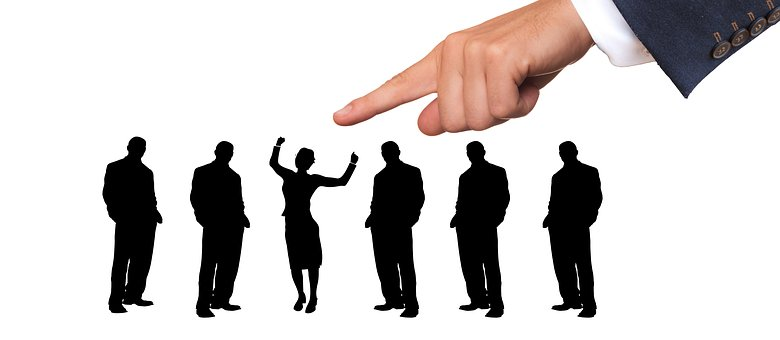 Finger pointing to dancing lady solhouette among 5 men silhouettes to signify Criteria for best affiliate marketing networks or programs to join