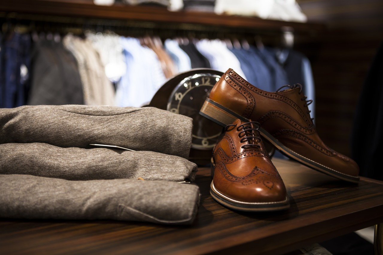 brown leather shoes and shirts