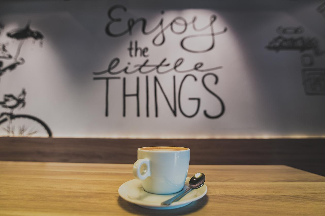 a cup of coffee in a coffee shop with sayings