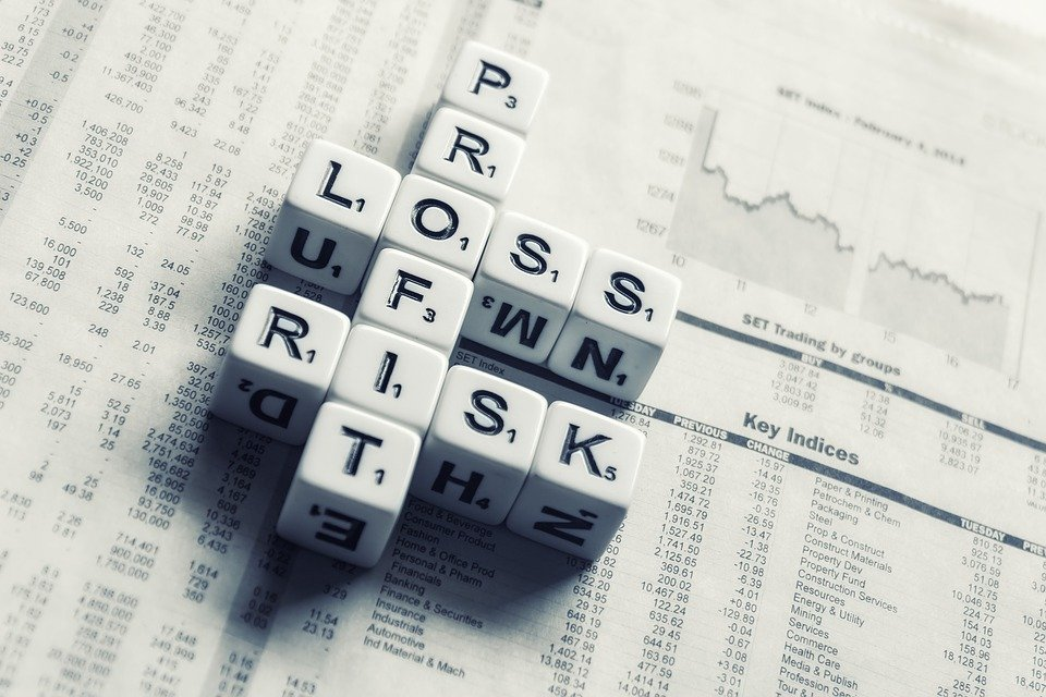 Dices Over Newspaper, Profit, Loss Risk, Wall Street