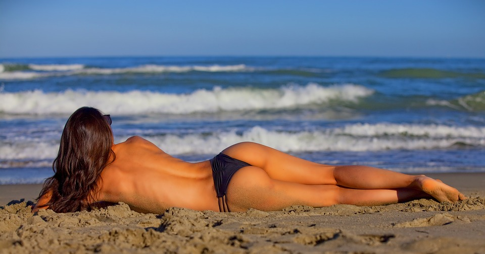 Naked women on beach photos