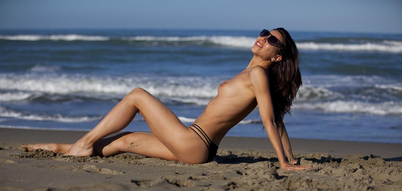 Topless Young Woman On The Beach By Alexey Kuzma