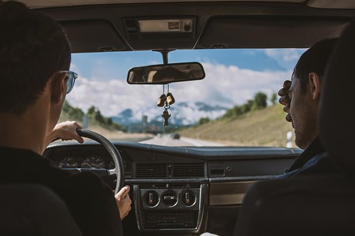 Two men travelling in a car