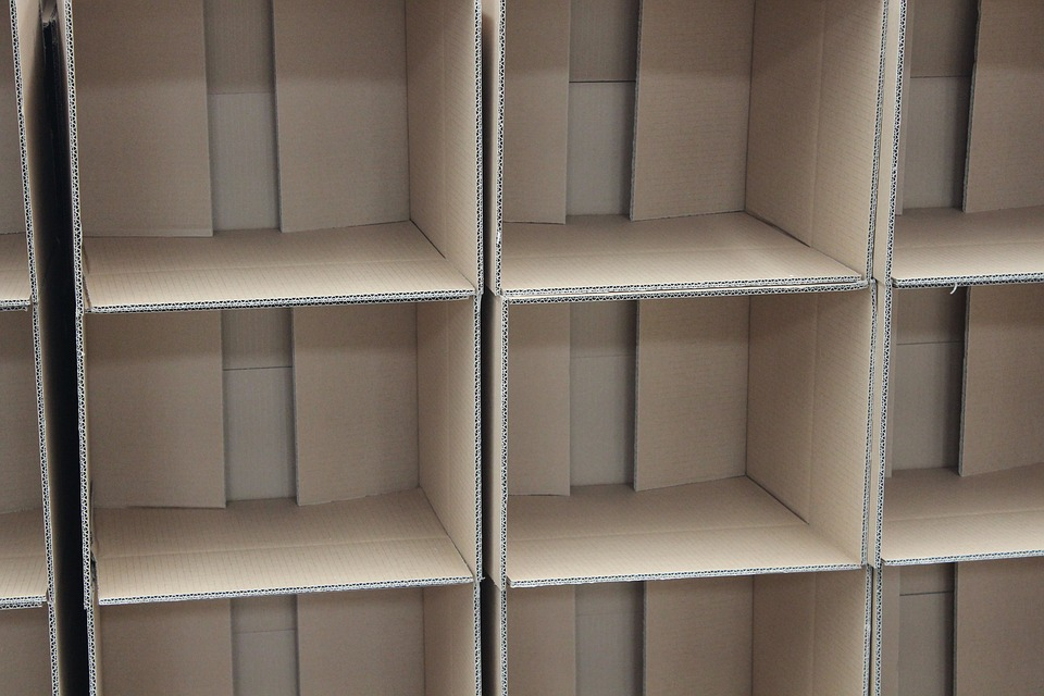 Packaging boxes for storage shelves