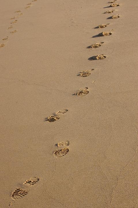 footprints sand beach free photo on pixabay