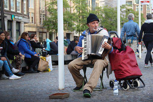 Man playing accordion in public