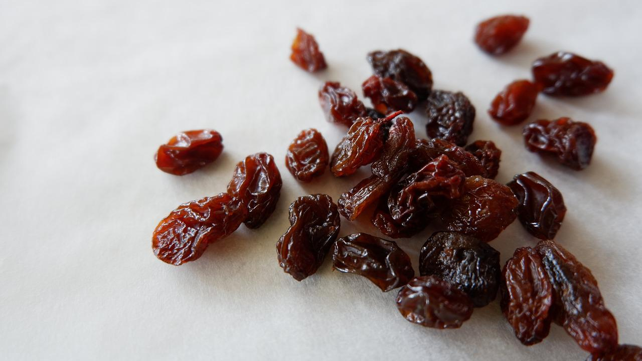 How are grapes primarily dried out to make raisins?