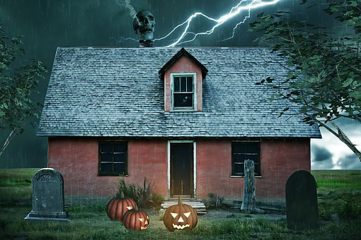 Haunted house with tombstone in front, lightning on the roof, etc.
