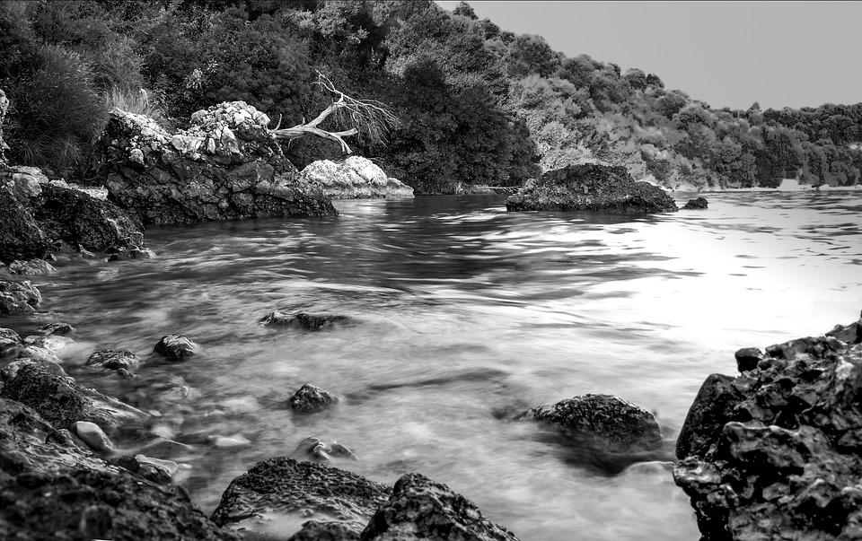 Black and white landscape sea red rock greece