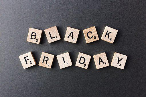 A Black Friday sales image made of the letters on wooden cubes on a dark background
