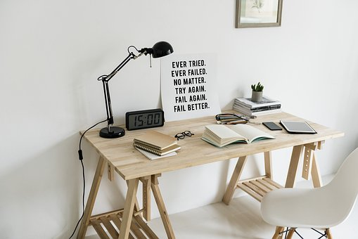 Workspace, woden table with books to signify writing copy