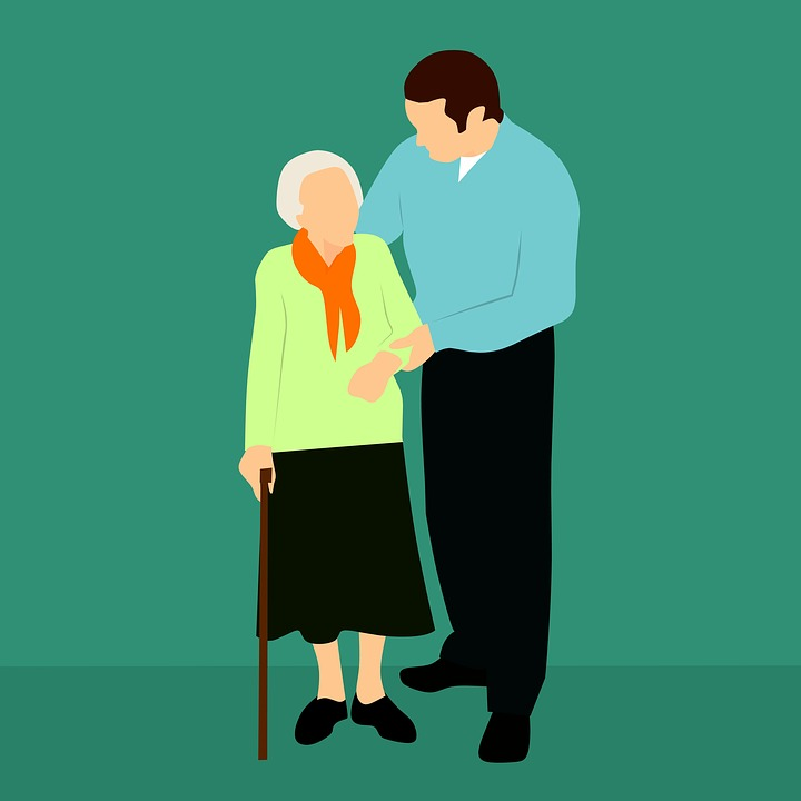 young person helping an elderly person