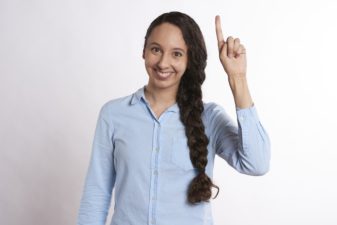 Woman with finger in the air.