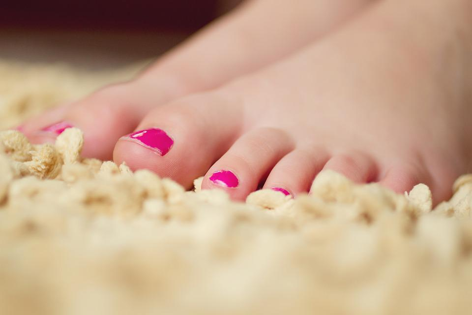 Photo of a feet with pink nail polish