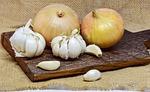 onion, garlic, cutting board