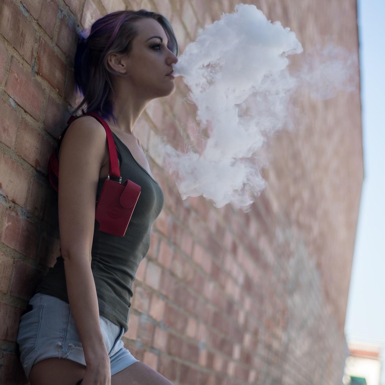 women smoke vape