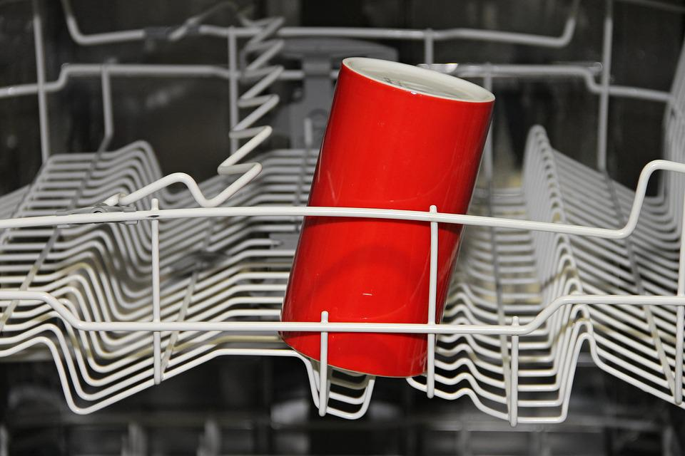 A red cup on a dishwasher
