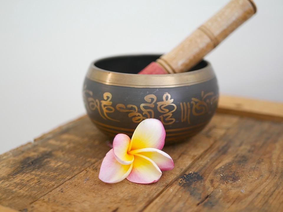 Singing bowl on brown wooden table