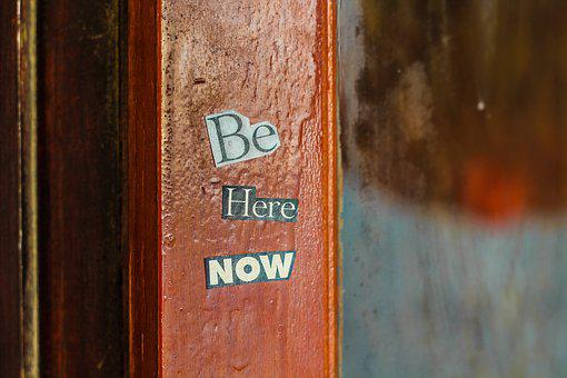 Old wooden door with words Be here now for 301 inspirational and motivational quotes