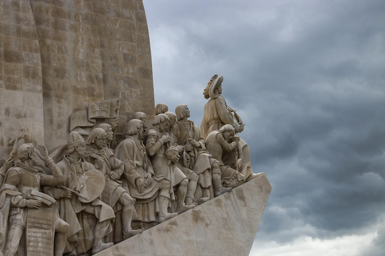 Stone relief of a group of conquistadors.