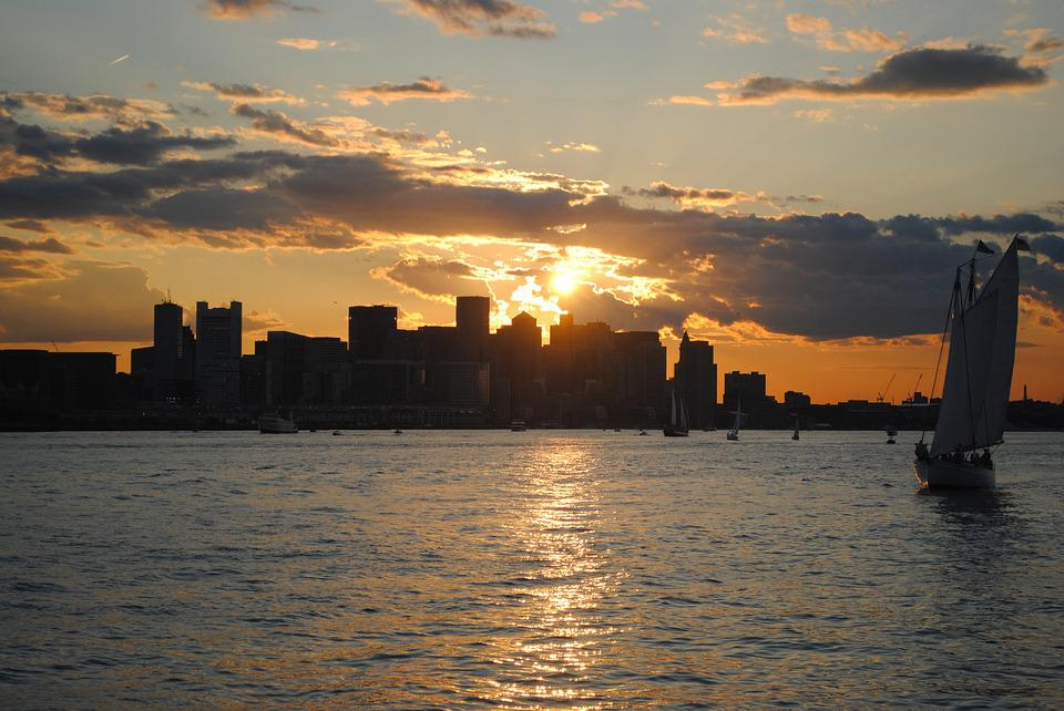 The sun setting over a Massachusetts city skyline.