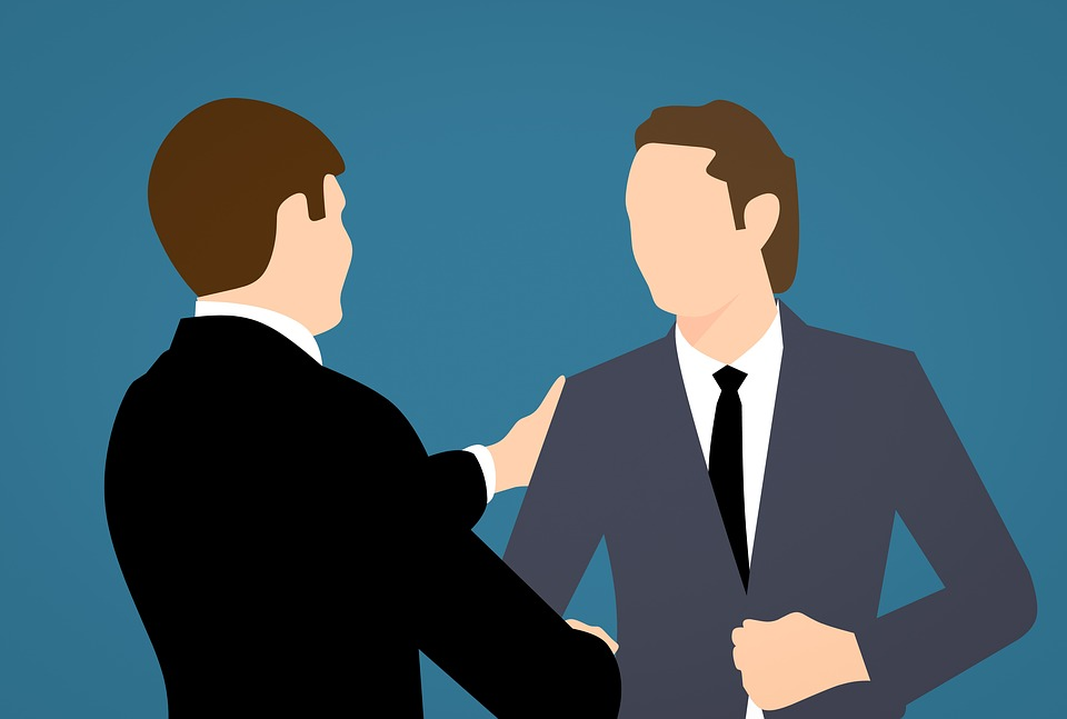 Two men in business avatar shaking hands