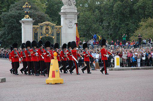 Buckingham Palace guards marching in front of the palace
