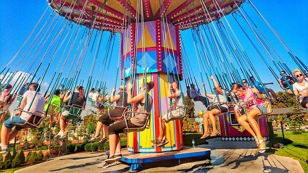 People sitting on a carousel, having fun