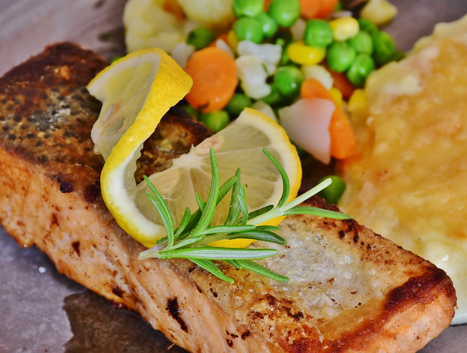 cooked salmon with a pretty lemon wedge on top
