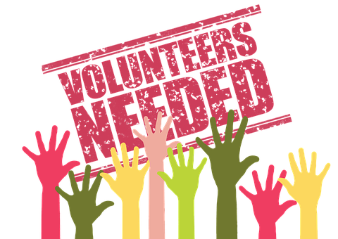 Drawing of colored hands reaching up to a red slating sign VOLUNTEERS NEEDED