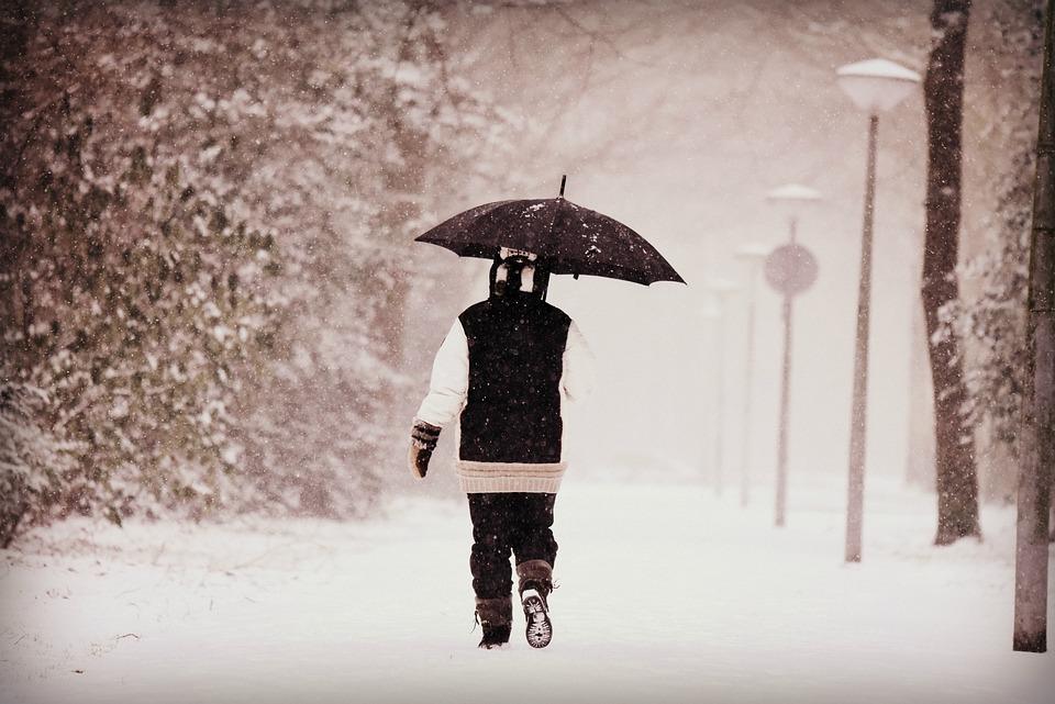 4f2f6cb070 person woman walking snow winter cold umbrella