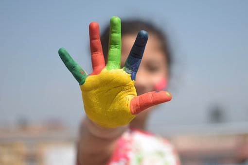 child's hand painted in different colors