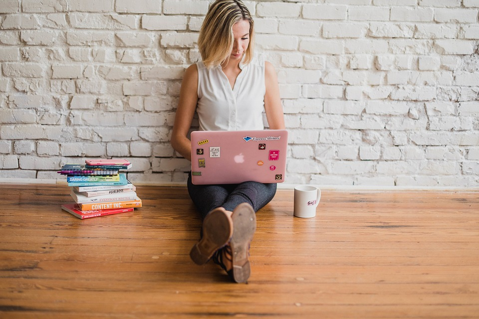 girl on a pink laptop