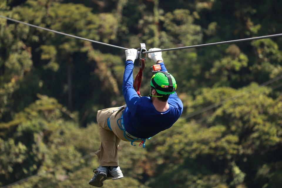 A guy ziplining