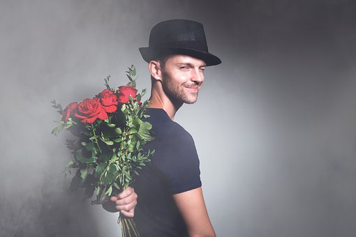 Man, Flowers, Romance, Young, Happy Know more about the days leading up to Valentine's day like Rose Day, Chocolate day and Anti-Valentine's day like break up day, slap day and more.