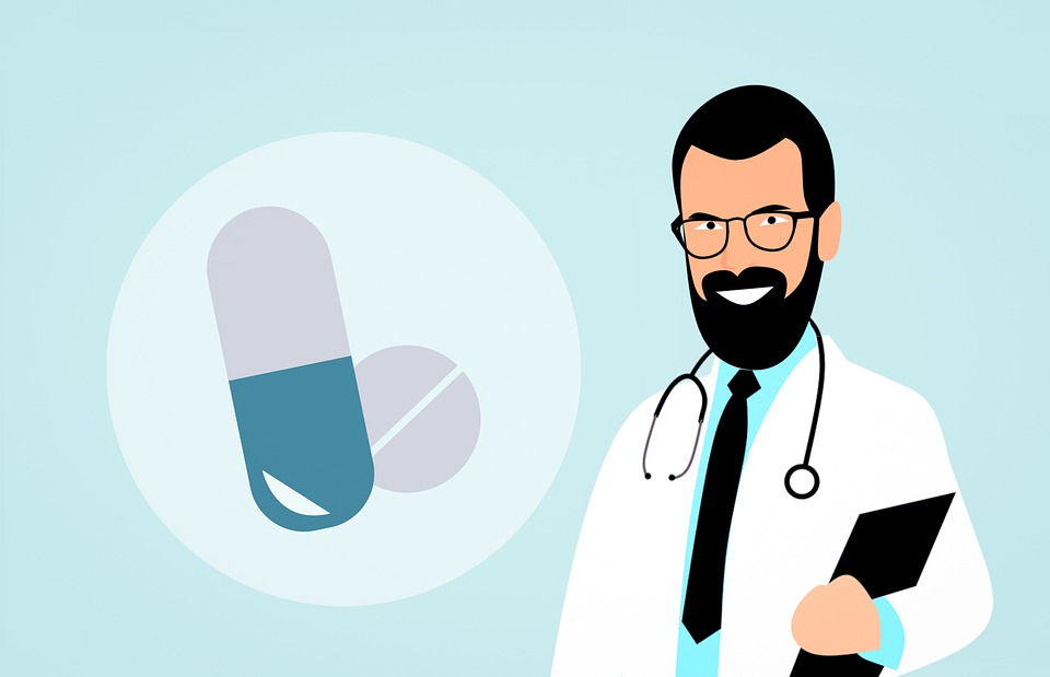 Clip art of two pills next to a doctor with a black beard in a white lab coat.