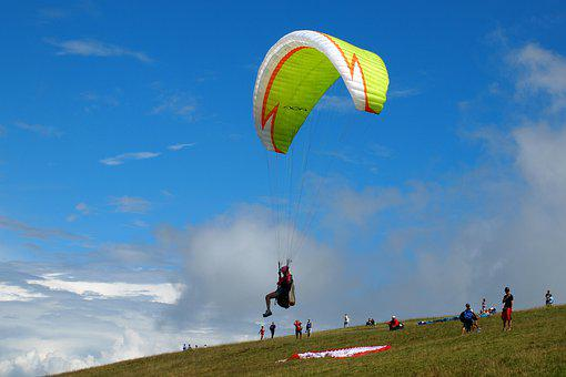 Paraglider about to jump offa hill