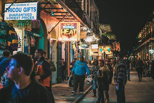 A street shopping scene with neon signs to signify choose the market for your affiliate marketing business