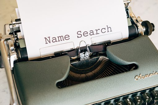 Typewriterwith paper sticking out of it bearing the words Name Search