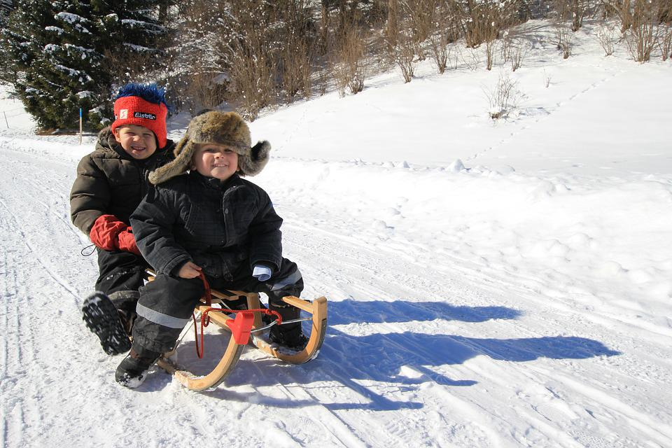 2 kids on a sled
