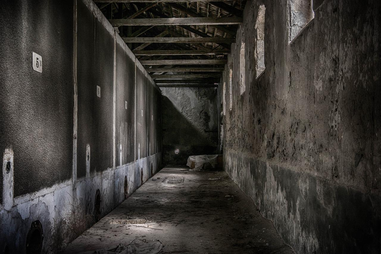 Empty concrete hallway in an abandoned buildings