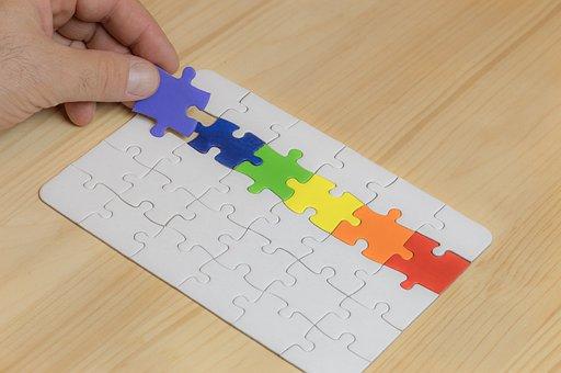 boy palying puzzle
