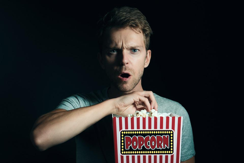 guy amazed with a cinema scene